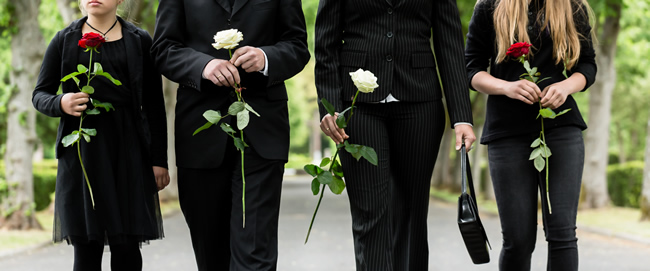 mourners holding flowers
