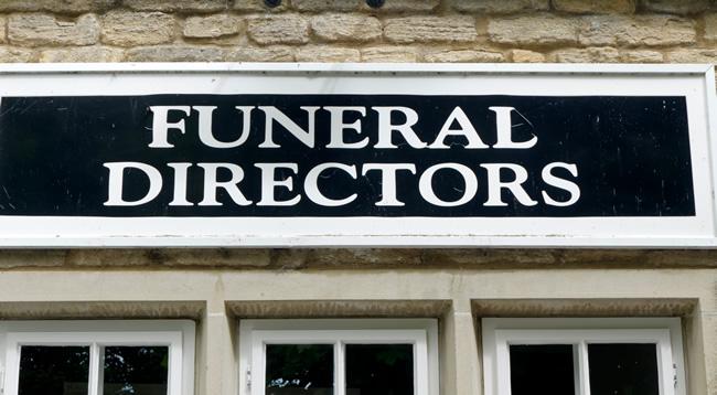 funeral directors sign on a shop
