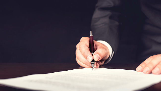 signing a piece of paper at a funeral