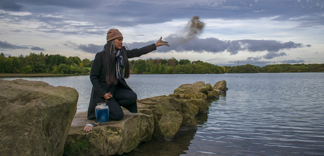 woman scattering her ashes